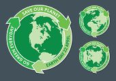foto of slogan  - Badges of globe and arrows with Earth day slogans written inside - JPG
