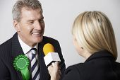 pic of politician  - Politician Being Interviewed By Journalist During Election - JPG