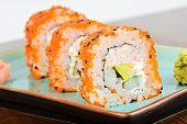 foto of masago  - Closeup California maki sushi with masago on the plate - JPG