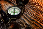 picture of longitude  - compass on wooden surface and steam - JPG