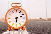 image of time-bomb  - Time Concept Alarm Clock on the Asphalt Street - JPG