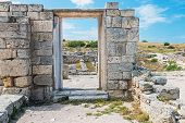stock photo of sevastopol  - wall of stones with a hole under the door - JPG