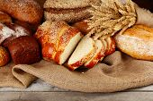 pic of sackcloth  - Different bread with ears on sackcloth background - JPG