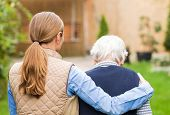 picture of geriatric  - Young carer walking with the elderly woman in the park - JPG