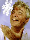 Dirty Senior Man with Snowflake in Winter