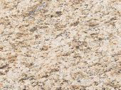 stock photo of slab  - spotted granite stone texture with small patches in the slab - JPG