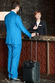 picture of receptionist  - Meeting a guest - JPG