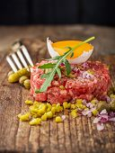 foto of tartar  - Close up of beef tartar with capers gherkins - JPG