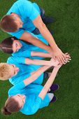 foto of joining hands  - People joining their hands  on green grass  - JPG