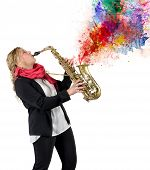 picture of saxophone player  - Woman plays beautiful notes from her saxophone - JPG