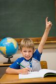 stock photo of pupils  - Pupils raising hand in classroom at the elementary school - JPG