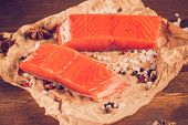 stock photo of salmon steak  - Two salmon steak on old papper with instagram style filter - JPG