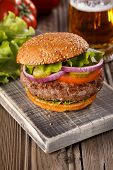 picture of burger  - Classic Burger on wooden background with glass of beer - JPG