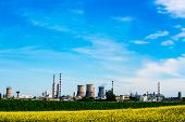 image of furnace  - Fuel refinery with furnaces under blue sky - JPG