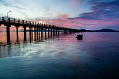 image of tide  - beautiful sunrise at the sea pier during tide - JPG