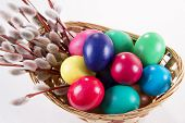 image of willow  - Wicker basket with colored eggs and willow branches on a white background - JPG