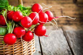 image of radish  - bright fresh organic radishes with leaves in a basket - JPG