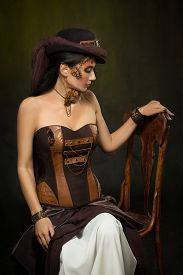 picture of steampunk  - Portrait of a beautiful steampunk woman over dark background - JPG