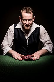 picture of gambler  - A male gambler feels fortunate and goes all inn - JPG