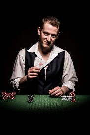 foto of gambler  - A male gambler makes four aces and winning hand - JPG