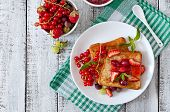 foto of french-toast  - French toast with berries and jam for breakfast - JPG