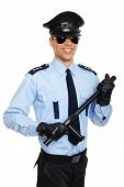 picture of policeman  - Smiling young policeman in sunglasses holding nightstick - JPG
