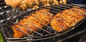 stock photo of salmon steak  - Grilled salmon steaks on the grill - JPG