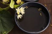 pic of teapot  - teapot and cup with linden tea and flowers - JPG