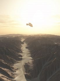 stock photo of spaceships  - Science fiction illustration of a spaceship flying over a canyon on a desert planet - JPG