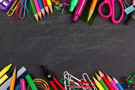 picture of chalkboard  - School supplies double border on a chalkboard background  - JPG
