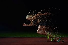 stock photo of sprinters  - pixelated design of woman  sprinter leaving starting blocks on the athletic  track - JPG