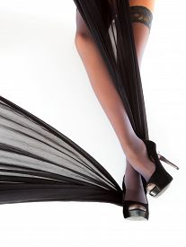 picture of fetish clothes  - Woman posing in shoes and stockings wrapped in silky cloth view 3 - JPG