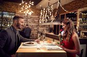 Couple in love celebrate Valentines Day with romantic dinner   poster