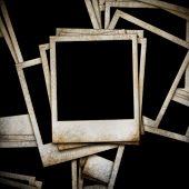 Grunge photo frames on wood background
