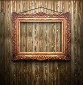 marco Vintage sobre fondo de madera