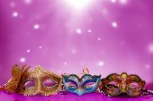Traditional female carnival venetian mask  on table .Masquerade  mask on  glitter background.Mardi G poster