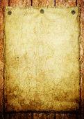 papel velho em madeira fundo (anúncio vintage)