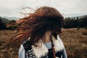 Beautiful Hipster Traveler Having Fun In Windy Mountains, Playing With Hair. Stylish Woman Hiking. W poster