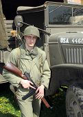 American soldier before military truck in Pilsen City Czech Republic Europe - Anniversary ends secon