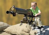 Little boy and big machine gun