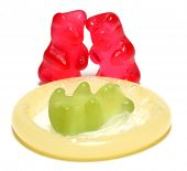 Red jelly bears parent and green jelly bear baby on a condom - conceptual image - on white backgroun