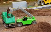 Green dumper and earthmover on a road building. Homemade RC model - plastic kit (  scratchbuild 1 :