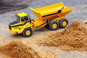 Yellow dumper on a road building. Homemade RC model - plastic kit (  scratchbuild 1 : 32 scale)