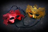Decorated masks for masquerade on black background.