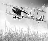 stock photo of ultralight  - Vintage style picture of a flying biplane  - JPG