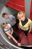 group of three young creative specialist on stairs