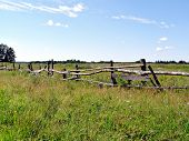 old fence on autumn field