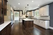 Kitchen in remodeled home with center island. poster