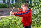 boy with slingshot