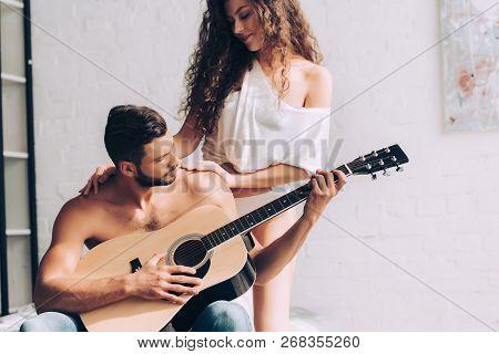 Handsome Shirtless Man Playing On